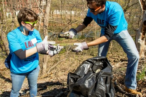 Hailey Votta '15 and Travis Barr '15 work as a team to keep the Karl Stirner Arts Trail clean.