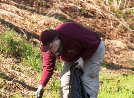 Charles Snyder '78 helps keep the Karl Stirner Arts Trail clean.