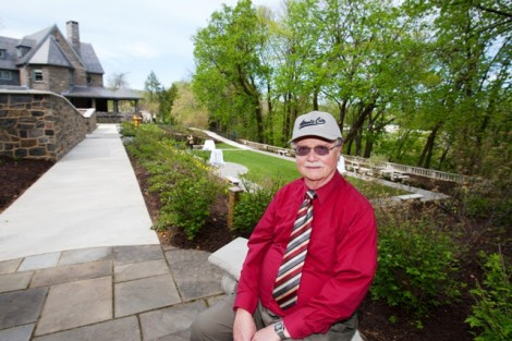 Robert A. Pfenning walks through the garden admiring the changes.