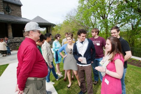 Robert A. Pfenning speaks with Jillian Andres '16, right, and other current McKelvy scholars.
