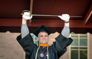 Pepper Prize winner Brad Bormann '14 presents the Marquis de Lafayette's sword to the Class of 2014
