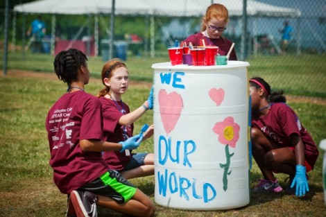 Students decorate compost bins at Metzger Fields.