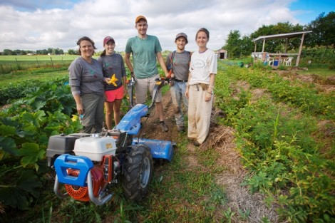 Sarah Edmonds, director of LaFarm, Kelly Carpency '16, Eric Giovannetti '15, Joseph Ingrao '16, and Jen Ruocco '14 after a hard day's work on the farm