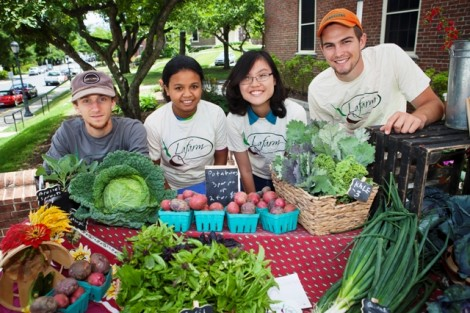 Joseph Ingrao '16, Prisca Ratsimbazafy '17, Hong Ha Vu '17, and Eric Giovannetti '15 sell vegetables at LaFarm's Summer Market outside Gilbert's Café.