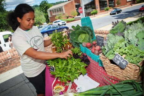 Prisca Ratsimbazafy '17 gets the vegetables ready for market.