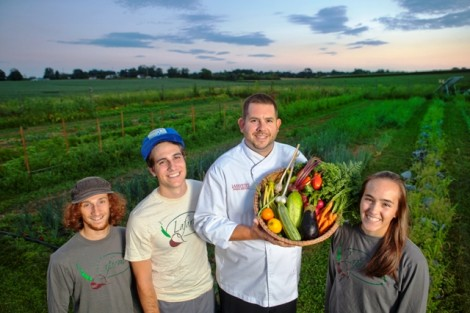 Joseph Ingrao 16, Kevin Jackson '16, John Soder, executive chef of dining services, and Kelly Carpency '16 hold some of the LaFarm produce that will be used in the dining halls.
