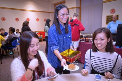 Students eat mooncake, the traditional pastry of the festival.