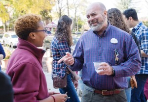 Stacey Ann-Pearson '15 speaks with Harlan Levinson '83 during the Lafayette Pride Network social outside Gilbert's Café.