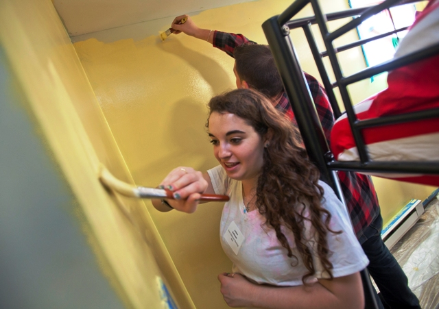 Ariana Rothman '18 paints a room at Safe Harbor homeless shelter.