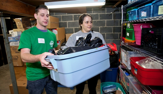 Josh Sperber '15 and Abby Williams '15 organize and inventory items at the Easton Area Community Center.
