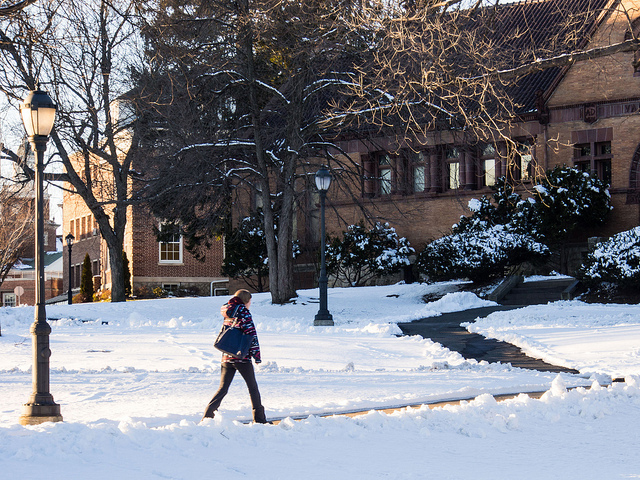 A student walks by Van Wickle Hall.