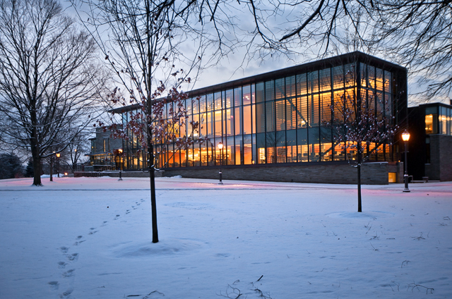 The lights go on in Skillman Library as the sun sets.