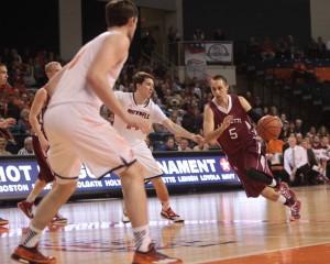 Joey Ptasinski '15 drives toward the basket against Bucknell.