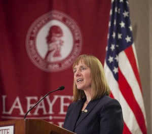 President Alison Byerly gives a speech at a podium