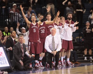 Lafayette players on the bench cheer as they and head coach Fran O'Hanlon watch the action against Bucknell