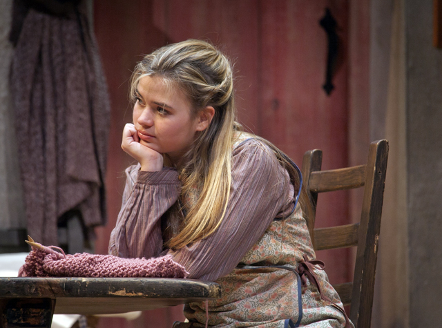 Meryl Hahne '18 sits in a scene in Dancing at Lughnasa