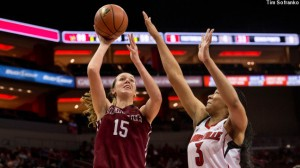 Women's basketball player Emily Homan '15 shoots the ball with a Louisville defender covering her.