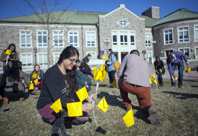 HSL president Alexandria Sousa '15 places flags in the ground.