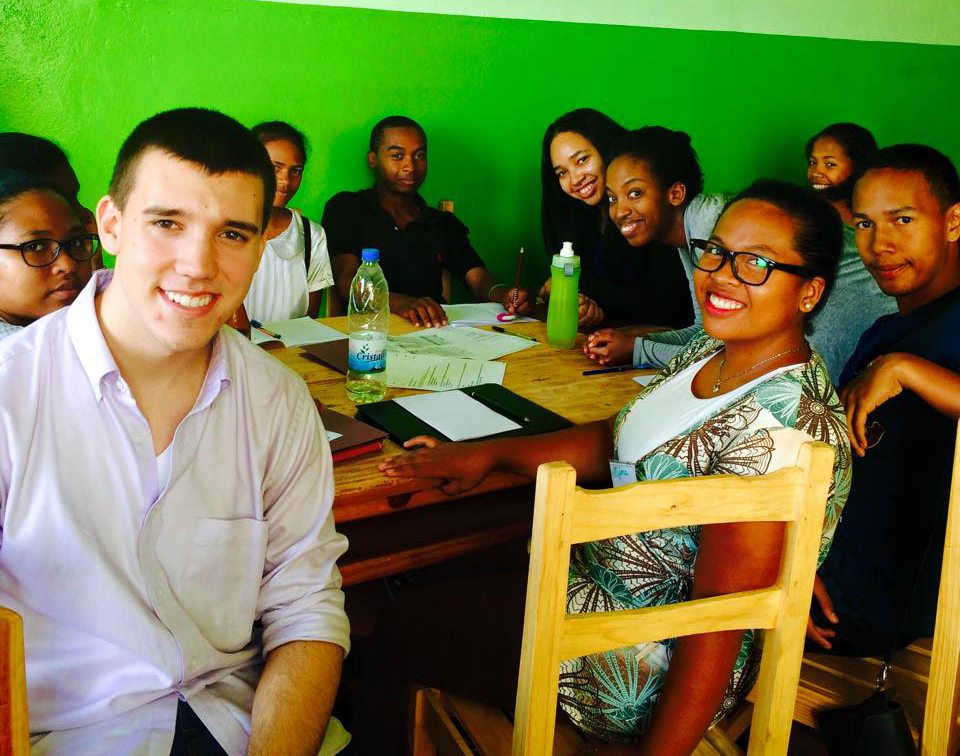 Stavros Kariofillis '17 and Alexis Grandy '17 work with students in the classroom.