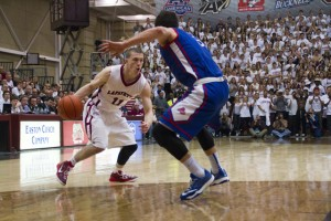 Nick Lindner drives to the basket while being defended by an American University player