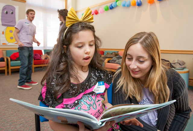 A student reads to Jessica Eggers '17.