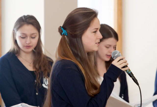Maggie Noonan '17 and other members of the female a cappella group Cadence entertain the kids.