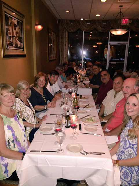 Alumni share a toast in Naples, Fla.