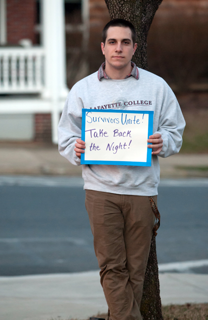 One of the members of Phi Kappa Psi fraternity who held signs with facts about sexual violence