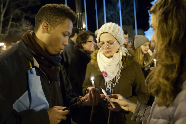 People light candles in support of victims of sexual violence.