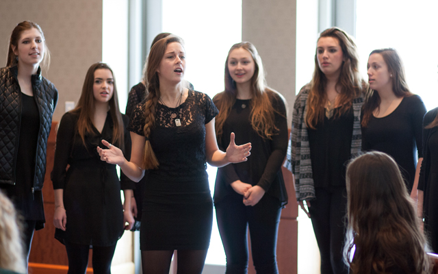 The female a cappella group Cadence performs.