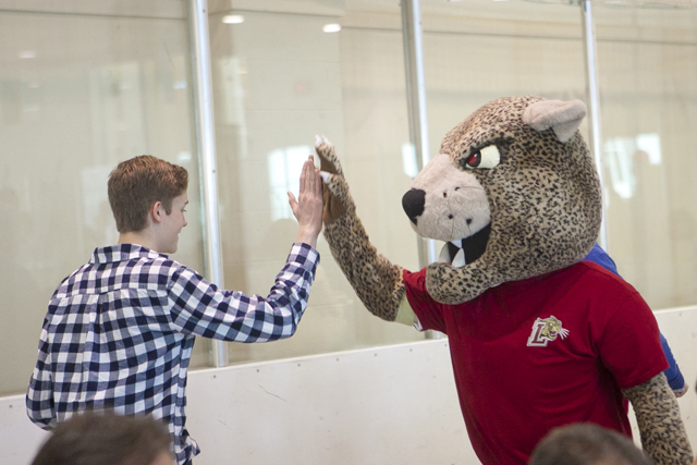 A prospective student makes friends with the Leopard.