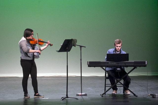 Elizabeth Kasumi '18 on violin and Johnny Gossick '18 on the keyboards