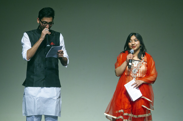 Cohosts Abdul Manan '18 and Monika Niroula '17 announce the acts.
