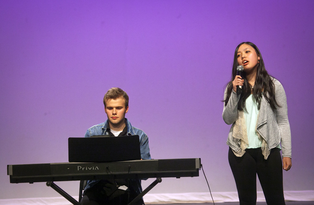 Johnny Gossick '18 accompanies Mayna Chen '18 singing