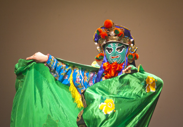 Yemai Liu '15 performs the Chinese Face Changing Dance.