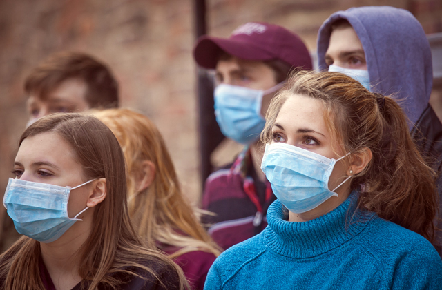Audience members wore surgical masks as they traveled through the venues.