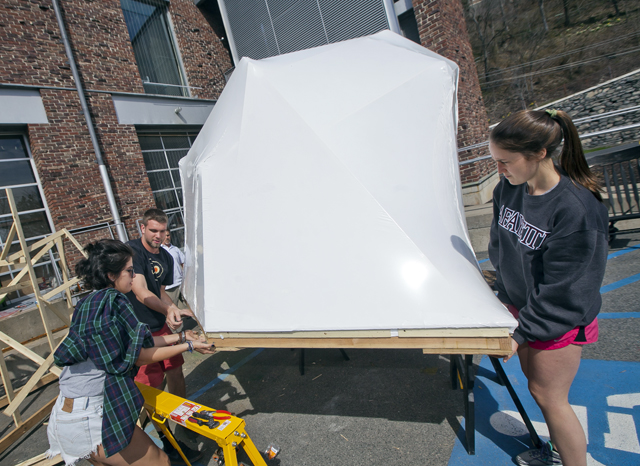Students build icebergs for the production in the Williams Visual Arts Building parking lot.