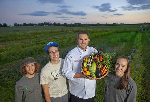 John Soder, executive chef of dining services, holds some of the LaFarm produce that will be used in the College dining halls.