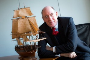 Miles Young, president of Friends of Hermione-Lafayette in America, with a model of the ship Hermione