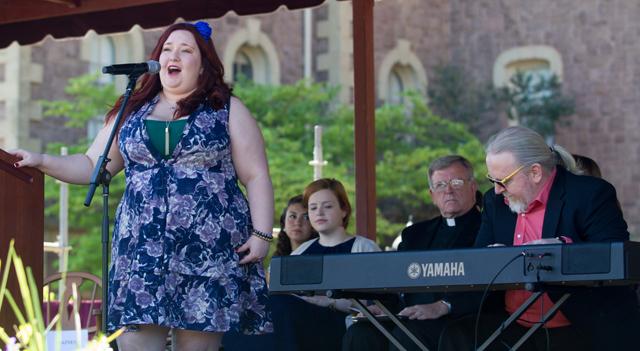 Nikelia Haines '15 sings