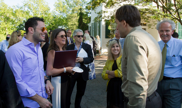 Commencement Speaker Eric Weihenmayer mingles with guests.