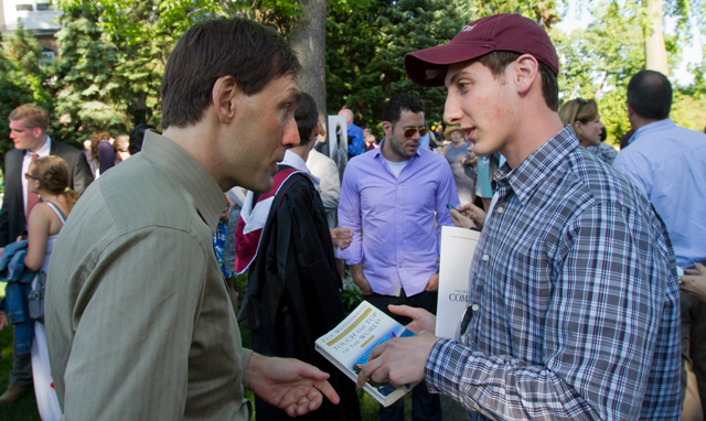 Commencement Speaker Eric Weihenmayer signs a copy of his book for Evan Gooberman '13.