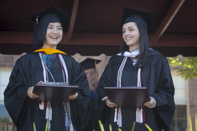Li Guo '15 and Heather Hughes '15, who both achieved the highest cumulative grade-point average in the class, were the first to receive their diplomas.