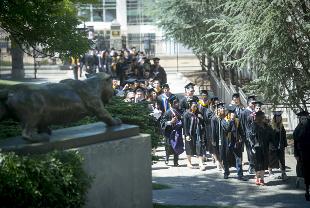 The academic procession makes its way to the Quad.