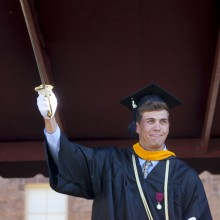 Cory Spera '15 waves the sword of the Marquis de Lafayette.