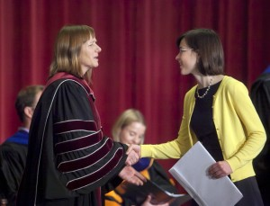 President Alison Byerly presents one of four awards to Emily Crossette '15.