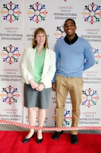 President Alison Byerly poses with Juannell Riley '15. Riley received two Intercultural Awards.