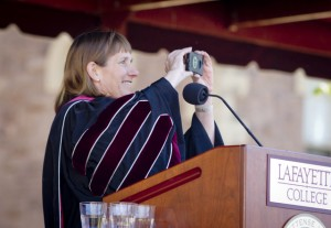 President Alison Byerly takes a photo of the crowd for Twitter.