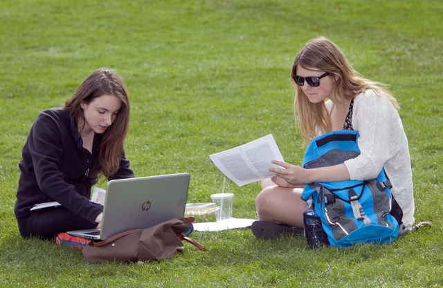 Students take advantage of the nice weather and study on the Quad.