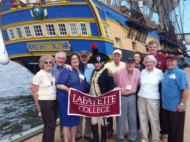 College Archivist Diane Shaw and several alumni join the Marquis in welcoming the Hermione to Yorktown.
